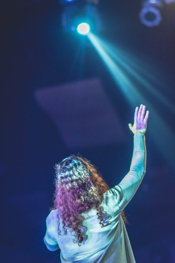 Raising hand on stage