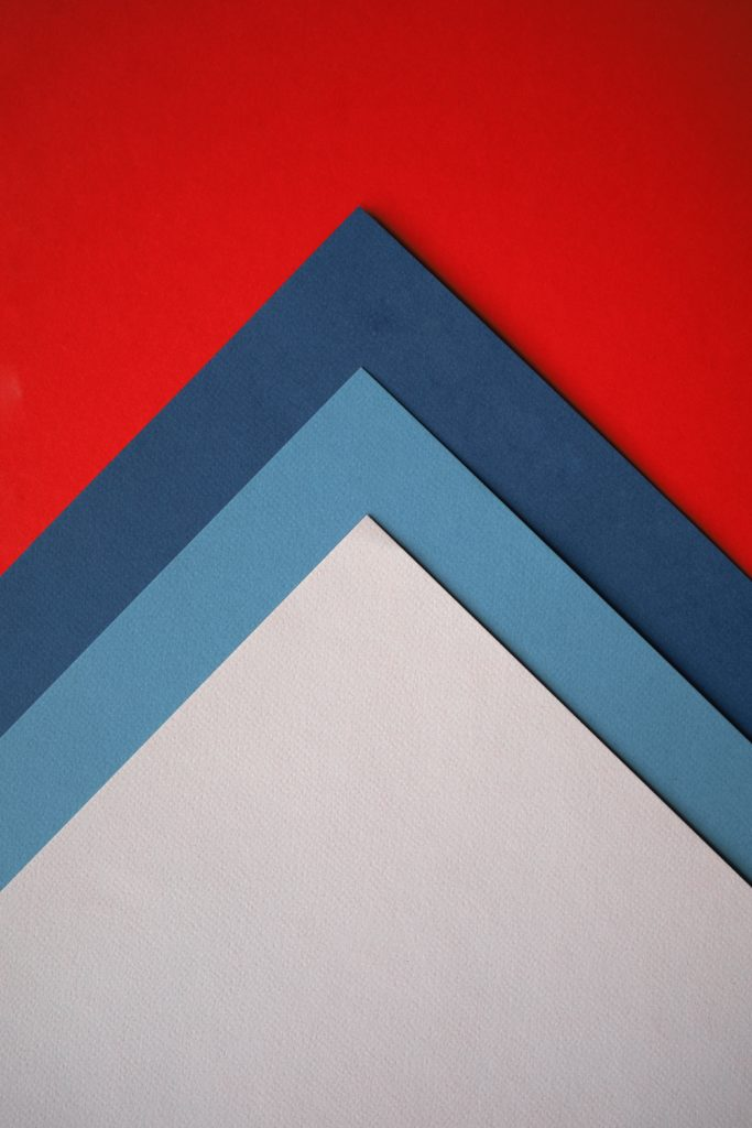 different colored pyramid shapes forming what looks like an arrow pointing up